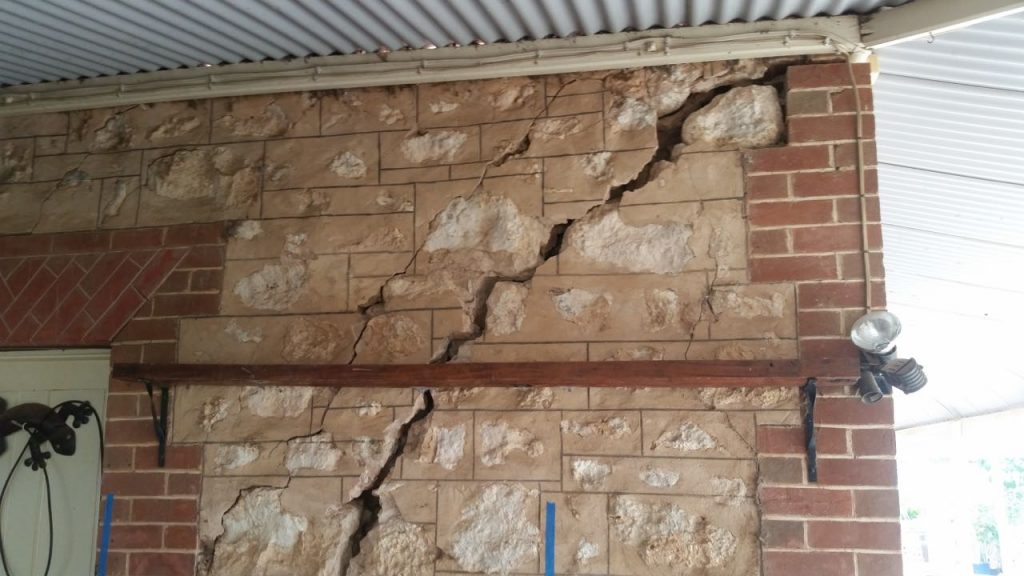 Crack in stone and brick wall before repair